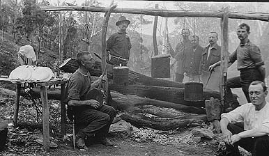 Men around the campfire in the Arkansas Ozarks